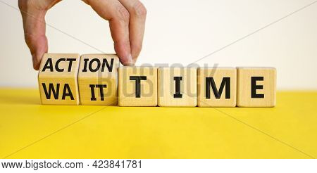Action Or Wait Time Symbol. Businessman Turns Wooden Cubes And Changes Words Wait Time To Action Tim