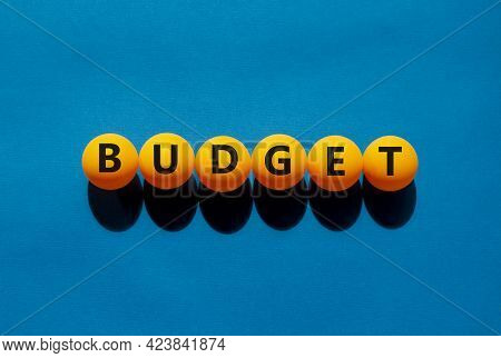 Budget And Business Symbol. The Concept Word 'budget' On Orange Table Tennis Balls On A Beautiful Bl