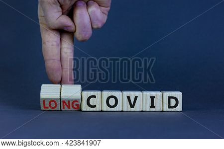 Long Covid Symbol. Doctor Turnes Wooden Cubes And Changes Words 'covid' To 'long Covid'. Beautiful G