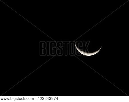 Closeup Of Bright Crescent Moon In Ecuador Showing Fine Detail Of Lunar Surface.