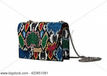 Close-up Of A Fashionable Small Handbag, A Snakeskin Clutch In Bright Colors.