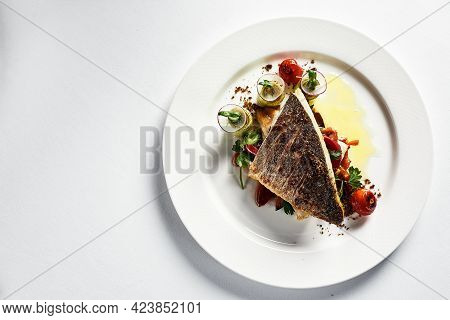 Grilled Seabass With Vegetables Top View, Close-up, White Plate, Light Background, Copy Space