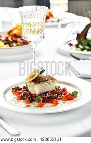 Fillet Of Pike Perch On Vegetables Light Plate, Festive Table, Pike Perch From The Chef With Wine