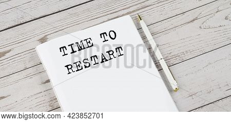 Notepad With Text Ptime To Restart . White Background. Business