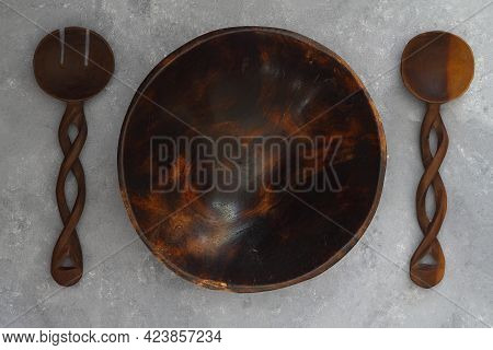Empty Round Handcrafted Brown Wooden Plate On Stone Concrete Background, Top View
