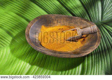 Curcuma Longa - Organic Turmeric Powder In The Wooden Bowl