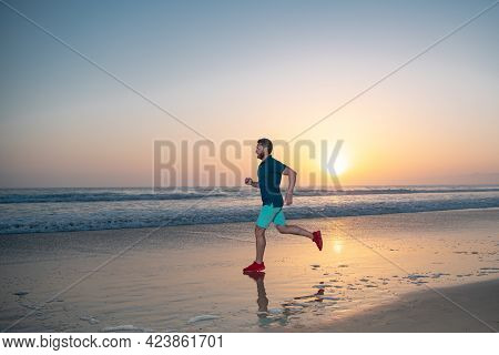 Active Healthy Runner Jogging Outdoor. Young And Active Jogger Running. Fit Male Fitness Runner Duri