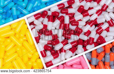 Top View Of Colorful Capsule Pills In Plastic Tray. Pharmaceutical Industry. Healthcare And Medicine