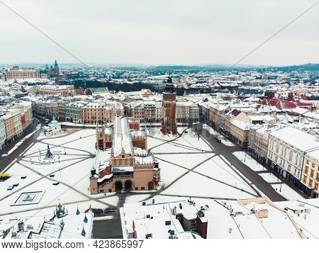 Aerial View Of The Town Hall Tower In The Old Square Of Krakow. Poland. City With Ancient Architectu