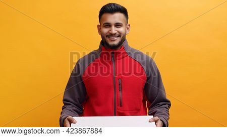 Delivery Man Holding A Pizza Box In His Hand. Dressed In Red Uniform Smiling. Concept Of Home Delive