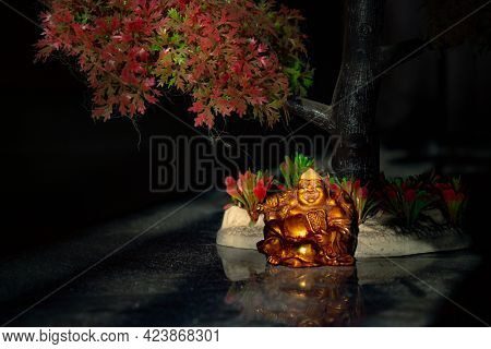 Laughing Buddha Statue On Under The Tree. Statue Of Laughing Buddha. Statue Of Kubera.