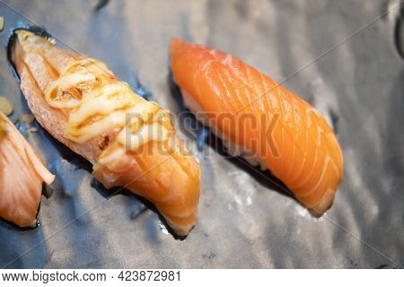 Burnt Salmon Sushi With Mayoungnes Sauce And Fresh Salmon Sushi Served On Plate In Japanese Restaura