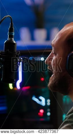 Streamer Man Talking Into Microphone With Other Players During Space Shooter Tournament. Online Stre