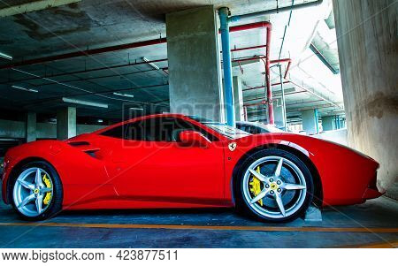 Bangkok, Thailand - 06 Jun 2021 : Side View Of Red Metallic Ferrari Car In The Parking Lot. Ferrari