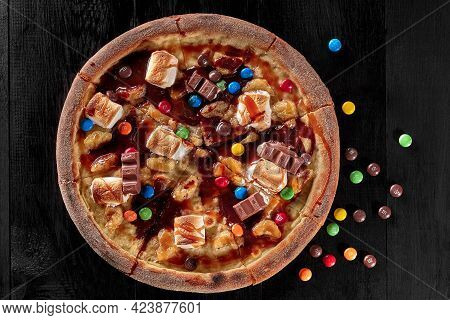 Top View Of Sweet Pizza With Caramelized Banana, Marshmallow, Chocolate Dragee