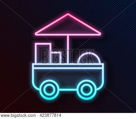 Glowing Neon Line Fast Street Food Cart Icon Isolated On Black Background. Urban Kiosk. Vector Illus