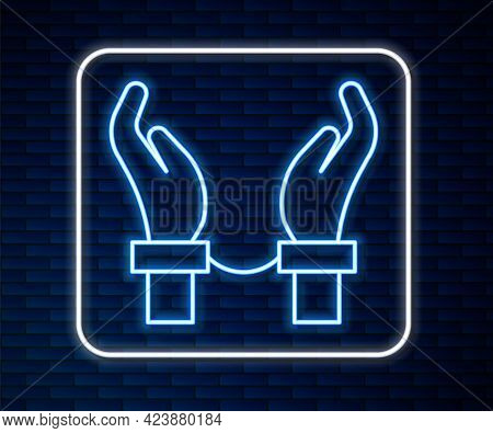 Glowing Neon Line Handcuffs On Hands Of Criminal Man Icon Isolated On Brick Wall Background. Arreste