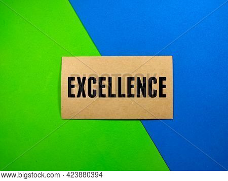 Education Concept.text Excellence On Brown Card With Green And Blue Background.