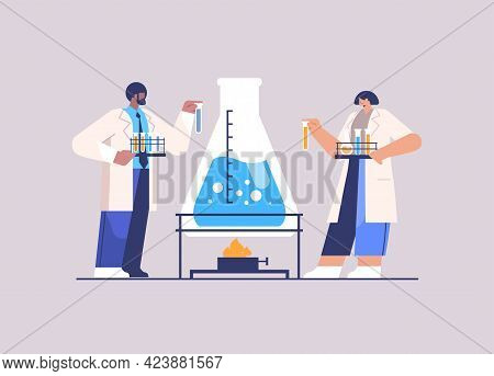 Research Scientist Working With Test Tube Researchers Making Chemical Experiment In Laboratory