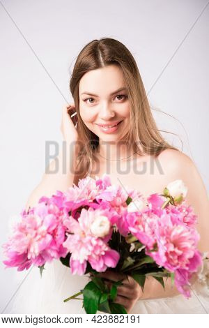 Beautiful Smiling Woman With A Wreath Of Peonies On The Head
