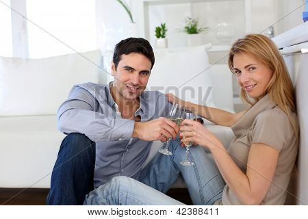 Romantic couple drinking wine at home