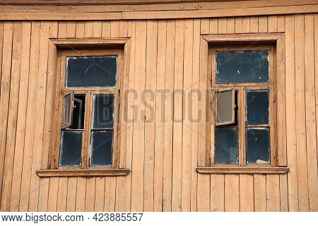 Two Windows With Wooden Frames In A Wooden Plank Wall, Wooden Background