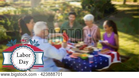 Composition of labor day text and logo over family having celebration picnic. patriotism, independence and celebration concept digitally generated image.