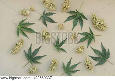 Cannabis Pattern On Grey Background. Marijuana Buds And Fresh Leaves, Flat Lat, Top View. Hemp Recre
