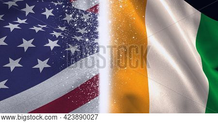Composition of billowing irish and american flags divided by glowing white line. patriotism, independence and celebration concept digitally generated image.