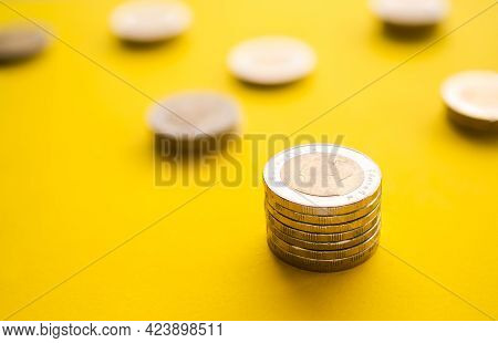 Thai Stack Coin 10 Baht On Yellow Paper Background. Growth Earn Money Investment And Saving Money Fu