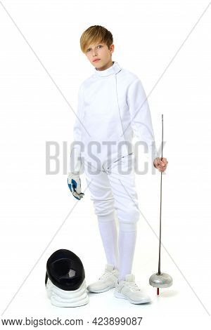 Boy In Fencing Costume Posing With Sabre And Mask. Portrait Of Handsome Teenage Boy Fencing Player W