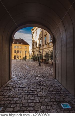 Sopron, Hungary - October 2018: Narrow Street With Old Houses And Arch In The Old Centre Town Of Sop