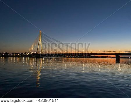 Cable-stayed Bridge Across The River. The Bridge With Night Lighting.