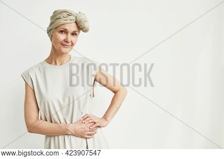 Minimal Waist Up Portrait Of Beautiful Mature Woman Wearing Headscarf And Smiling At Camera, Copy Sp