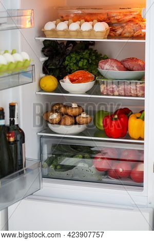 Full Fridge Of Healthy Food. Proper Nutrition. The Keto Diet. Refrigerator With Healthy Food. Produc