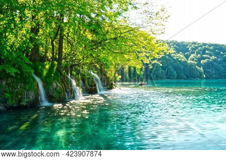 Boat On Plitvice Lakes With Waterfall Long Exposure In Hdr In Croatia, Europe