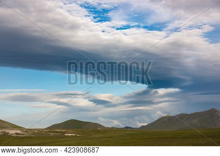 Natural Landscape With Dramatic Sky Over Mountains