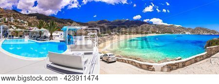 Greece summer holidays. Ios island, Cyclades. Luxury hotel with swimming pool and stunning view for Mylopotas beach. Ios Palace Hotel and Spa, may 2021