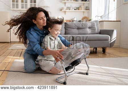 Playful Caucasian Mother Bonding With Little Preschool Son: Happy Mom And Kid Have Fun At Home Near