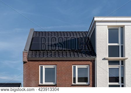 Newly Build Houses With Solar Panels Attached On The Roof Against A Sunny Sky Close Up Of New Buildi