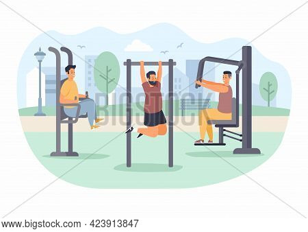 People At Outdoor Gym. Man With Beard Pulls Up On Horizontal Bar. Guys Work Out Muscles On Simulator