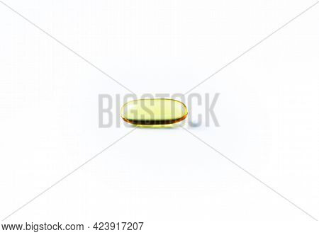 Fish Oil Capsules On White Background And Texture., Fish Oil Capsules And Container., Selective Focu