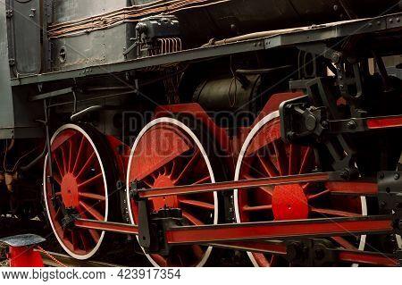 Old Vintage Black And Red Wheels Steam Locomotive On Railroads
