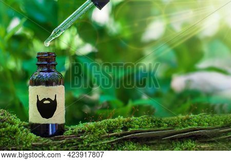 Natural Beard Oil, Brown Bottle, Pipette. Beard Oil Over Green Natural Background. Copy Space For Te