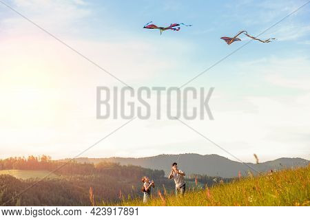 Kids Playing: Sister With A Brother With Launching Colorful Kites - Popular Outdoor Toy On The High