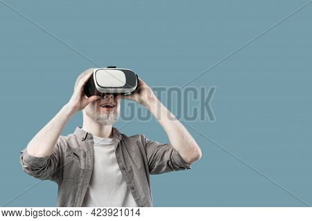 Virtual Gadgets For Entertainment. Joyful Albino Guy Wearing Vr Headset, Turquoise Background With F