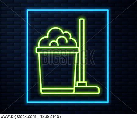 Glowing Neon Line Mop And Bucket Icon Isolated On Brick Wall Background. Cleaning Service Concept. V