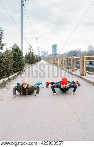 Two Fit Woman Friends Exercising Outdoor. Girl Friends Doing Plank Pose Exercise Outdoors. Fitness W