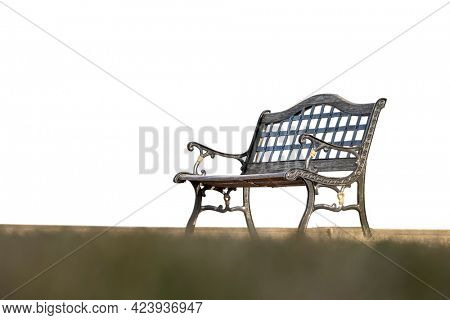 Wrought iron park bench against white background