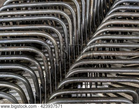 Industrial Background Of Bent Steel Pipes - Close-up With Selective Focus